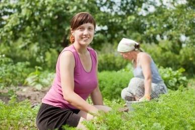 Lady in vegetable garden