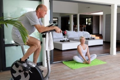 Mature couple exercising at home