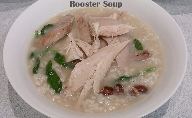 Rooster soup with kidney beans spinach and rice in bowl