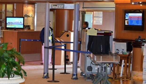 Security staff check point for returning passengers on board Sea Princess