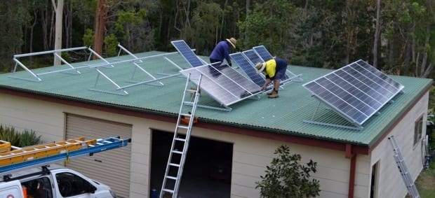 Solar install fixing panels to frames 5kw pv system
