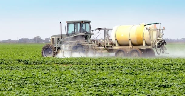 Tractor spraying vegetables chemicals