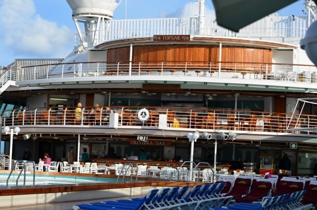 Three decks of bars and grills over looking the pool area on Sea Princess cruise ship