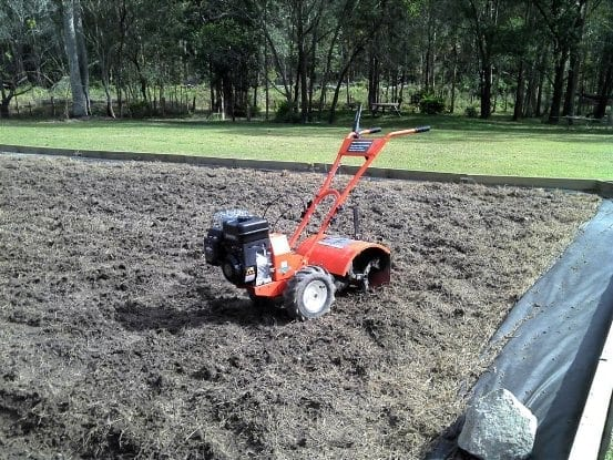 Tiller/rotary hoe with picnic area in background