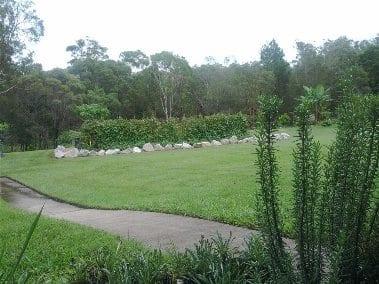 Vegetable garden rock border showing slope water run off