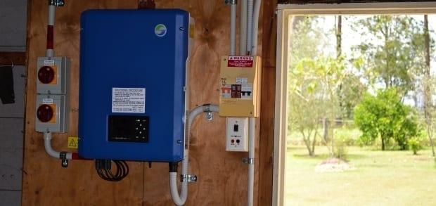 solar inverter installed in shed near doorway neat