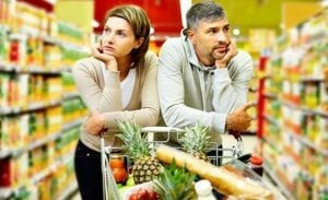 supermarket unhappy couple pushing trolly